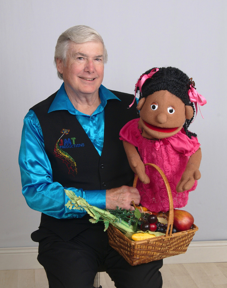 Mr. T, the Jamila puppet, and a basket of vegetables