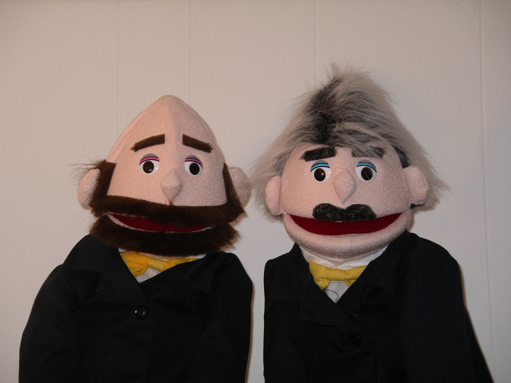 Two commentator puppets