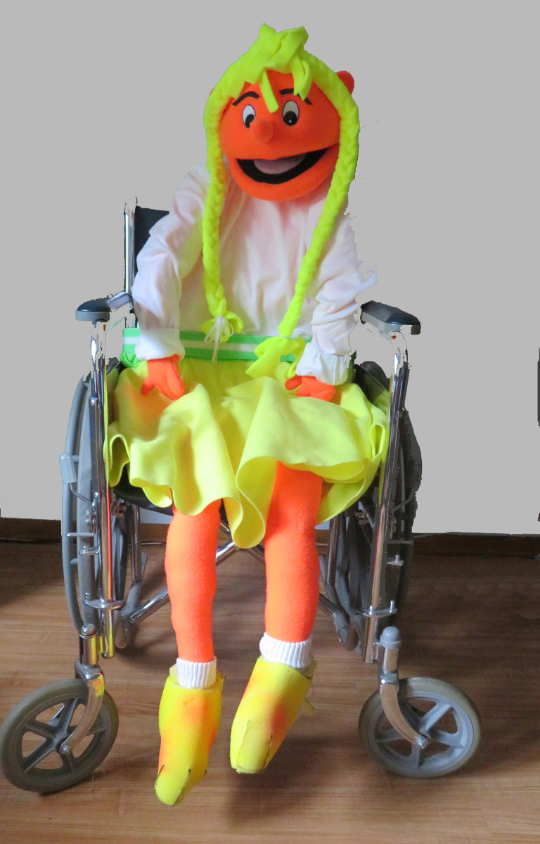 The Zoe puppet (in a wheelchair)