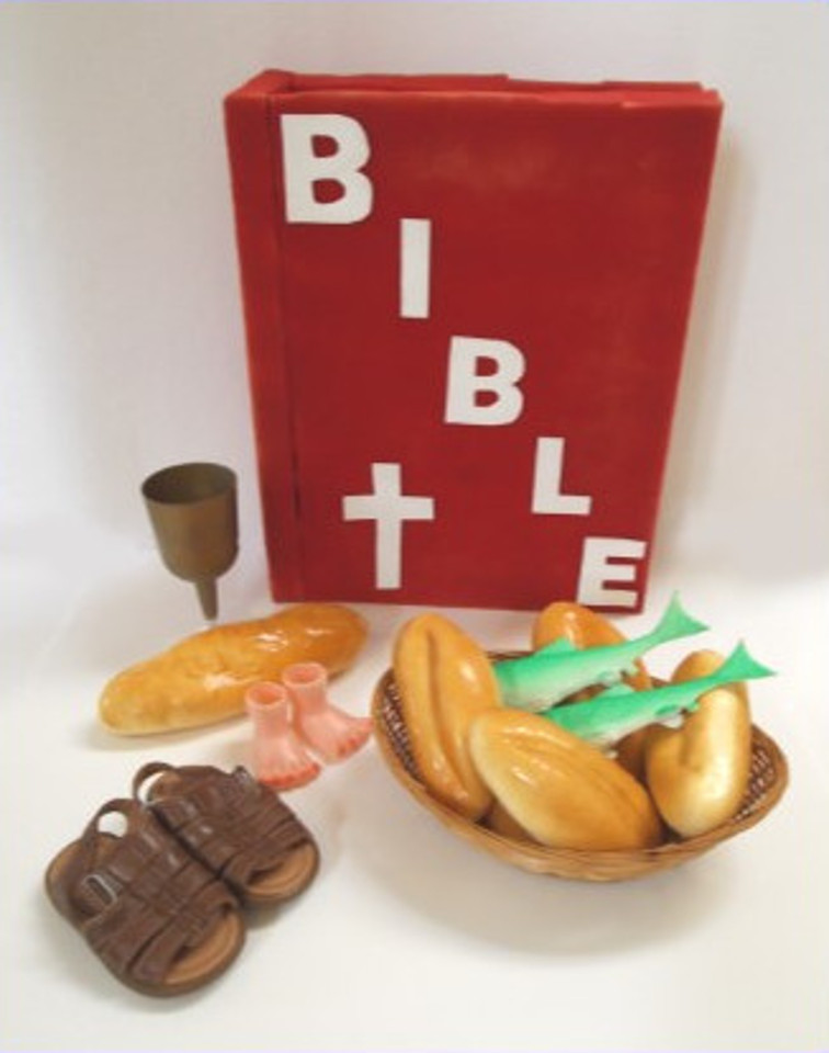 The Bible, five loaves, two fish, sandals, and a chalice
