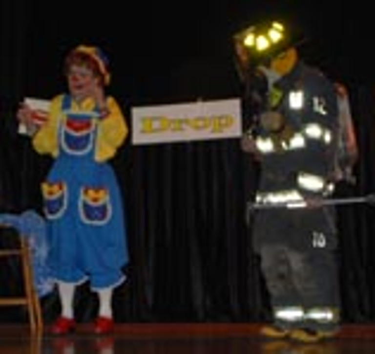 Rainbow and a firefighter in full gear