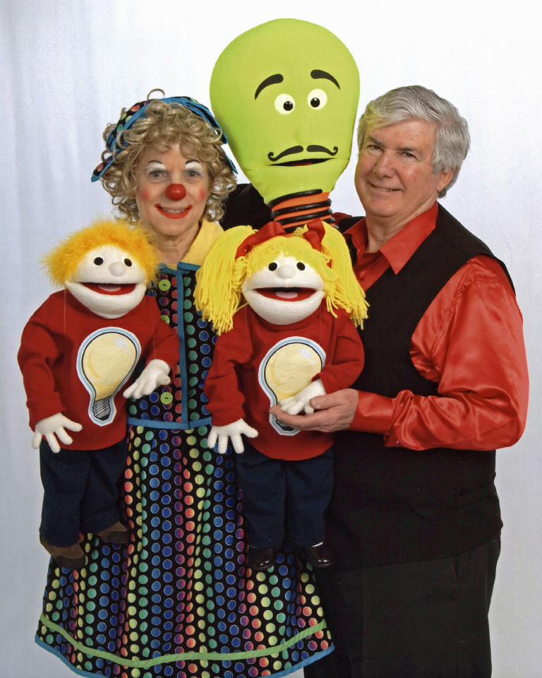 Rainbow the Clown and Mr. T with three puppets